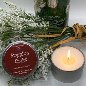 popping corks travel tin candle